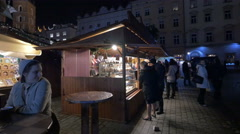 People buying from Gofry Kawa food stall at the Christmas market in Krakow Stock Footage