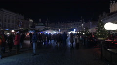 People at the Christmas market in Krakow, at night Stock Footage
