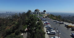 Buzz over Griffith Observatory to downtown LA - stock footage