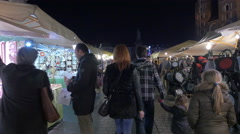 Father and children walking near street stalls at the Christmas market in Krakow Stock Footage