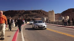 Traffic and Tourists Cross Hoover Dam Stock Footage
