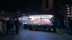 Street stalls with sweets and clothing at the Christmas market in Krakow Stock Footage