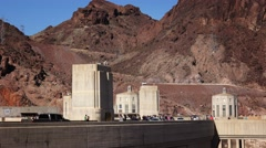 Automobiles and Tourists Move Along the Hoover Dam Stock Footage