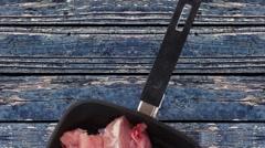 Raw turkey meat steak fillet over blue wooden table Stock Footage