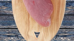 Raw turkey meat steak fillet over blue wooden table Stock Footage