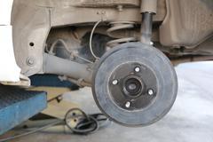 Wheel hub of a car in repair of the damage. - stock photo