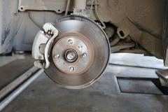 Wheel hub of a car in repair of the damage. Stock Photos