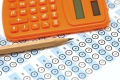 Answer sheet test score with pencil and calculator Stock Photos