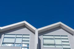 Houses against clear blue sky Stock Photos