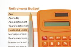 retirement plan document with pen and calculator - stock photo