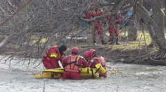 Fire Rescue Remove Body from River  - stock footage