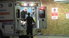 Ambulance Unloading Patient - stock footage