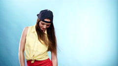Woman casual style cap on head on blue. Fashion shot 4K Stock Footage