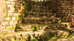 Blond Girl Goes up Stone Steps to Pavilion in Park Stock Footage