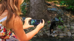 Closeup Backside Blond Girl Takes Photo of Monkey in Park Stock Footage