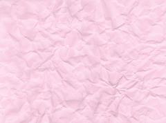 Texture of crumpled pink paper. Stock Photos
