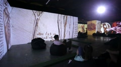 "People watch multimedia exhibition ""Renaissance - Live canvases"". Stock Footage"