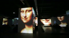 "People watch multimedia exhibition ""Renaissance - Live canvases"" Stock Footage"