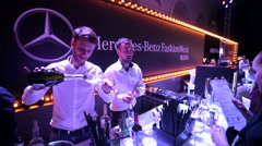 Bartenders offer drinks for visitors. Stock Footage