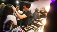 Mary Kay visagists makes professional makeup for visitors Stock Footage