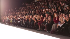 Grateful audience applaud and take pictures during fashion show Stock Footage