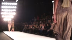 Out of focus background, models walk the runway during fashion show. Stock Footage