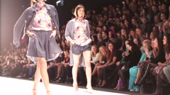 Spectators watch fashion show - stock footage