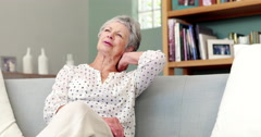 Senior woman suffering from neck pain Stock Footage