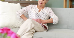 Senior woman suffering with a belly pain Stock Footage