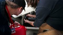 """refuel gasoline of racing bolide """"Estonia-8"""" - stock footage"""