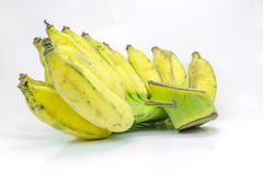 Peeled cultivated banana on white background. Stock Photos