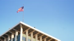 American Flag Atop Bank of America Tower in Beverly Hills  	 Stock Footage