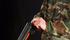 Man unloads hunting rifle - stock footage