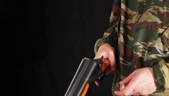 Man loads hunting rifle - stock footage