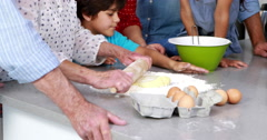 Multi-generation family baking together - stock footage