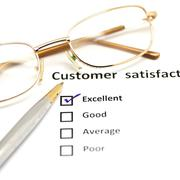 Stock Photo of customer satisfaction survey form with the pen and glasses