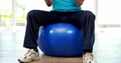 Senior man sitting on exercise ball Stock Footage