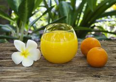 Fresh and colorful orange juice in spa healthy club Stock Photos