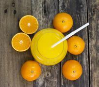 Glass of orange juice top view on the table Stock Photos