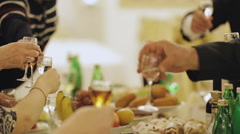 Holiday people clink glasses and drink - stock footage