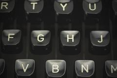 Close up of lettered keys on an old typewriter. Vintage filter applied. Stock Photos