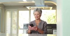 Senior couple using smart phone - stock footage