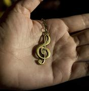 Music clef on hand - stock photo