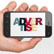 Marketing concept: Hand Holding Smartphone with Advertise on  display - stock illustration