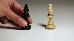 Hand putting down chess piece Stock Footage