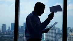 Businessman walking by window and throwing documents, super slow motion 240fps Stock Footage