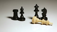 Hand putting down chess piece - stock footage