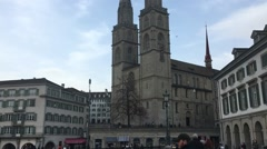 Tilt down of Grossmunster church in Zurich, Switzerland. Stock Footage