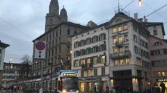 Stock Video Footage of Tram going down a street in Zurich, Switzerland.