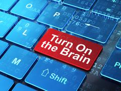 Learning concept: Turn On The Brain on computer keyboard background - stock illustration